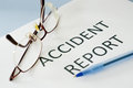 Accident report on blue background Royalty Free Stock Photos