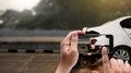 accident on street, damaged automobiles take photo car crash ac Royalty Free Stock Photo