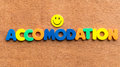 Accomodation colorful word on the wooden background Stock Image