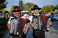 Accordian players two playing in a festival in monchique algarve portugal Royalty Free Stock Photo