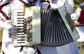 Accordion artist dressed in white playing the Stock Photography