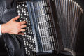 Accordion closeup of musician playing the on a black background Stock Photography