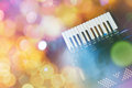 Accordion with color bokeh light in background Royalty Free Stock Photos