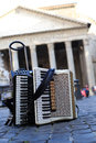 Accordion and harmonica in the background of pantheon in rome Royalty Free Stock Images