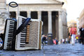 Accordion and harmonica in the background of pantheon in rome Royalty Free Stock Photos