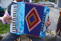 Accordion street musician playing colored Stock Photos