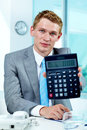 Accountant with calculator Royalty Free Stock Photography