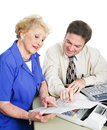 Accountant with client giving financial advice to a senior woman white background Stock Photography
