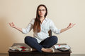 Accountant sitting in yoga pose on the table Royalty Free Stock Photo