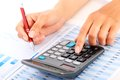 Accounting concept hands pen and calculator Stock Photo