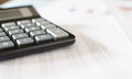 Accounting desktop with a calculator closeup Royalty Free Stock Photo