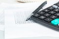 Accounting desktop closeup a calculator next to pen and financial documents abstract concept Stock Images