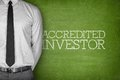 Accredited investor text on blackboard with businessman side Royalty Free Stock Image