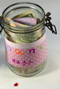 Accumulate money in a glass jar Royalty Free Stock Photo