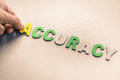 Accuracy hand arrange wood letters as word Royalty Free Stock Photography