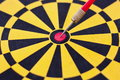 Accurate close up image of dartboard and arrow to show concept of in business by image of arrow on the middle of dartboard Stock Image