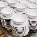 Accurate pile stack of the round ceramic white empty copyspace d closeup dish plates Stock Photo