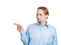 Accusations closeup side view profile portrait serious man pointing with index finger at someone isolated white background space Royalty Free Stock Photo