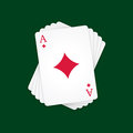 Ace of diamonds at the top the deck cards on green background Royalty Free Stock Photos