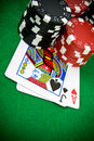 Ace of hearts and black jack with poker chips Stock Images