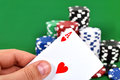 Ace jack in hand and poker chips stack Royalty Free Stock Photo