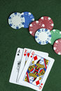 Ace king queen cards poker chips baize and and gambling on green table top copyspace Royalty Free Stock Photography