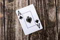 Ace of spades card on wood from a deck cards laying vintage table background old west salon style Royalty Free Stock Images