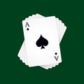 Ace of spades at the top the deck cards on green background Stock Images