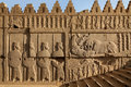 Achaemenid Bas Relief Carvings of Lion and Bull Combat Beside Soldiers in Persepolis Royalty Free Stock Photo