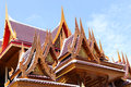 Achitecture building of ancient wooden roof temple in thailand with fine carving Stock Photo