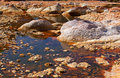 Acidic rio tinto orange stones in niebla huelva spain Stock Photo