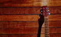 Acoustic brown guitar in wooden stripes Royalty Free Stock Photo