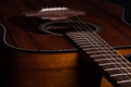 Acoustic guiar close up image of an guitar on a black background Stock Images