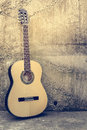 Acoustic guitar against a grunge textured wall Stock Photography