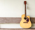 Acoustic guitar background on old wall Stock Photography