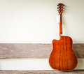 Acoustic guitar background on old wall Stock Photo