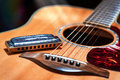 Acoustic guitar with blues harmonica country Royalty Free Stock Photo