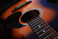 Acoustic guitar closeup of a six string Stock Images