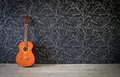 Acoustic guitar in empty room background Royalty Free Stock Images