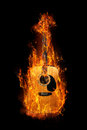 Acoustic guitar enveloped in a bright flame Royalty Free Stock Image