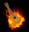 Acoustic guitar in fire flame vector illustration on black Royalty Free Stock Photo