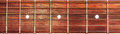 Acoustic guitar fretboard background Royalty Free Stock Photo