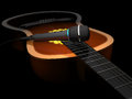 Acoustic guitar and microphone on a dark background 3d illustra