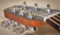 Acoustic guitar neck head with tuning pegs Royalty Free Stock Image