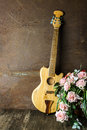 Acoustic guitar with old steel background Royalty Free Stock Photography