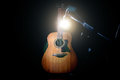 Acoustic guitar over black background Royalty Free Stock Photo