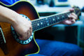 Acoustic guitar playing man players right hand using the sound hole Royalty Free Stock Photography