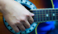 Acoustic guitar playing man players right hand using the sound hole Royalty Free Stock Photos