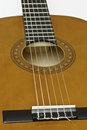Acoustic guitar showing the sound hole rosette and bridge Stock Photography