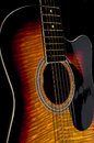 Acoustic guitar sunberst black background Stock Photo